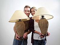 Portrait of a couple holding lamps
