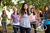 Hispanic girls playing with hula hoops