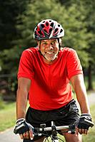 African man riding bicycle