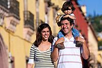 Hispanic family with boy on father's shoulders