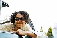 African woman in convertible car