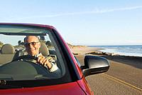 Senior German man driving convertible car (thumbnail)