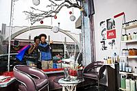 Multi_ethnic couple looking in salon window