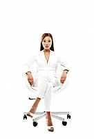 Asian businesswoman sitting in chair