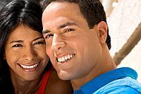 Close up of Hispanic couple smiling
