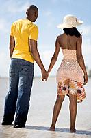 Multi_ethnic couple holding hands at beach