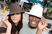 Hispanic couple wearing hats