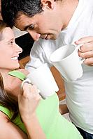 Hispanic couple drinking coffee
