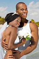 African bride and groom hugging