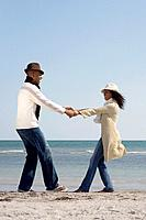 Multi_ethnic couple dancing at beach