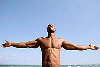 Bare_chested man with arms outstretched