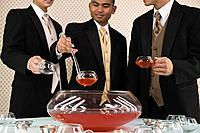 Multi_ethnic teenaged boys drinking punch