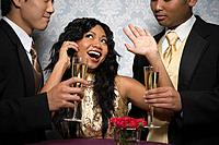 Multi_ethnic friends drinking champagne