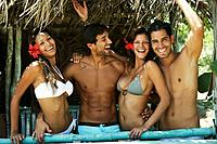 Hispanic couples in beach hut (thumbnail)