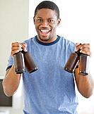 African man holding bottles of beer
