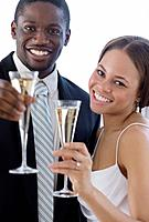 African newlyweds toasting with champagne
