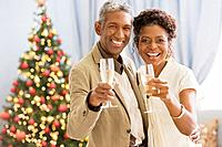 African couple toasting with champagne