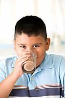 Hispanic boy drinking chocolate milk