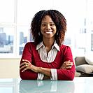 African businesswoman sitting at table