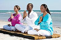Multi_ethnic friends meditating