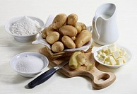 Still life: White potatoes, flour, sugar, milk and butter
