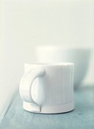 White mug on pale blue wood kitchen table