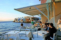 Group of people sitting in a restaurant, Mykonos, Mykonos Island, Cyclades Islands, Greece