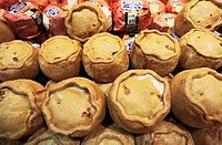 Close-up of pork pies in the display window of a store, Ye Olde Pork Pie Shoppe, Melton Mowbray, Leicestershire, England