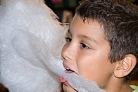 little boy eating candyfloss