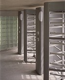 CITY OF MANCHESTER STADIUM, MANCHESTER, GREATER MANCHESTER, UK, ARUP ASSOCIATES, INTERIOR, TURNSTILES WITH EXIT BUTTONS AND GLASS BLOCKS