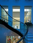 ASPREY COURTYARD DEVELOPMENT, 169 NEW BOND STREET, LONDON, W1 OXFORD STREET, UK, FOSTER & PARTNERS, INTERIOR, STAIR AND VIEW INTO STORE AT DUSK