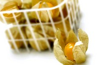 Close_up of a basket of physalis fruit