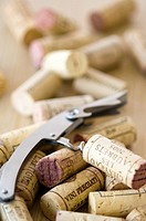 Close_up of corks and a corkscrew