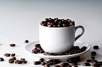 Close_up of coffee beans in a cup
