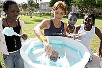 Florida, Miami, Legion Memorial Park, Arts for Learning Winter Arts Festival. Elementary school students making cotton candy. USA.