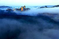 Castle of Montfort in the morning mist, built in the 12th century, Montfort, Dordogne, France