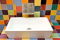 Italy, home interior, bathroom, sink with colourful background