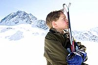 Boy holding skis