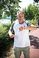 Jogger checking wristwatch