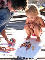Little girl and man drawing a picture
