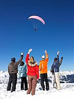 Group waving at parachutist