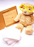 Teddy bear and calendar