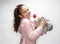 Girl laughing at hen