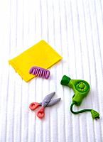 Paper clay toy, hair drier, comb and scissors