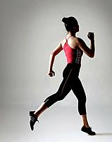 Young woman running with sportswear
