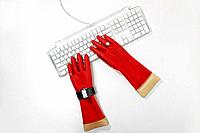Keyboard and red rubber glove