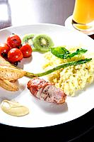 Potato, sausage, omelete with vegetables