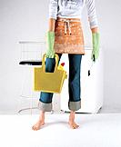 Woman carrying cleaing products in bag