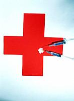Syringe and red Cross