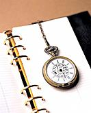 Pocket watch on notebook